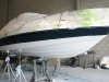 Bayliner 205 perched on stands during curing time.